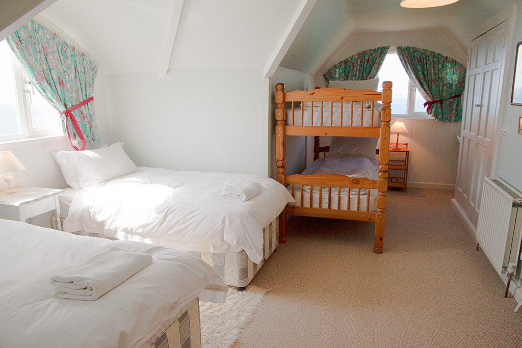 Bedroom with single beds and bunk beds Rinsey Head