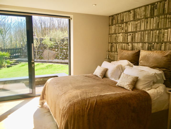 Bedroom view towards the garden - The Summer House from Stylish Cornish Cottages
